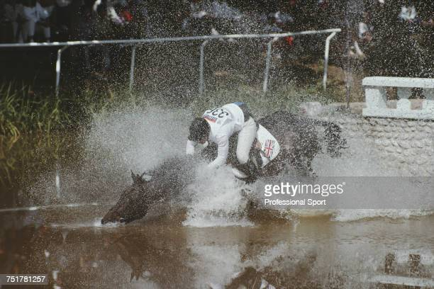English equestrian Karen Straker pictured in action for the Great Britain team on her horse 'Get Smart' at the water jump during competition to...