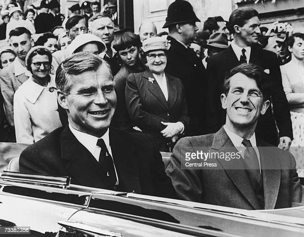 English explorer Vivian Fuchs and New Zealander Sir Edmund Hillary drive in triumph through the streets of Wellington after their return from the...