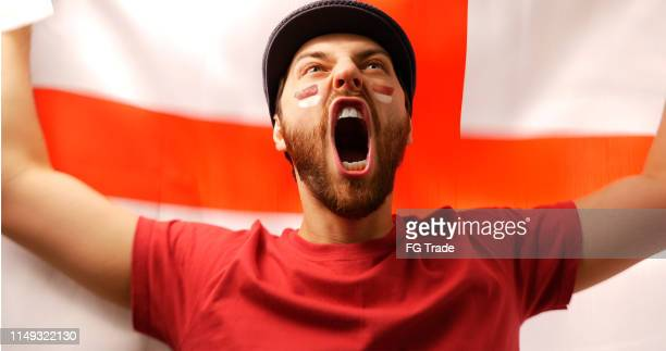 english fan celebrating with the national flag - football league stock pictures, royalty-free photos & images