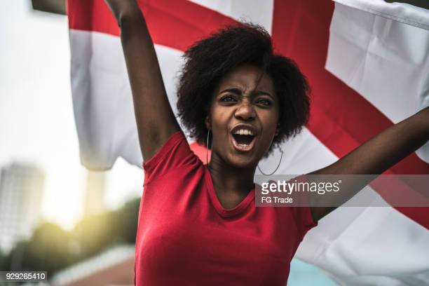 english fan watching a soccer game - england flag stock photos and pictures