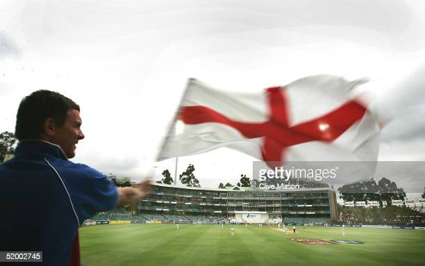 A english fan waves a St George cross flag during day five of the 4th Test between England and South Africa on January 17 2005 at the Wanderers...