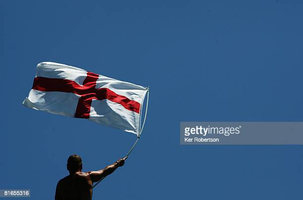 English fan waves the Cross of St George flag during qualifying for the French Formula One Grand Prix at the Circuit de Nevers MagnyCours on June 21...