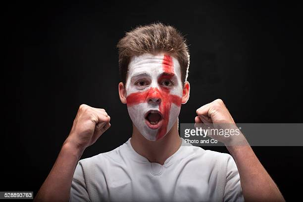 English fan with painted face
