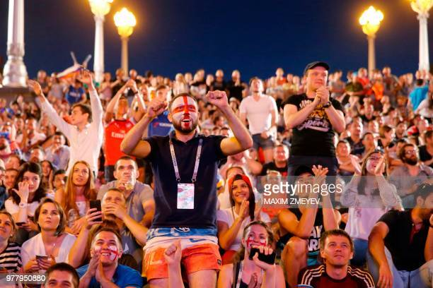 English fans at a Fan Fest celebrate their team's opener as they watch the Russia 2018 World Cup Group G football match between Tunisia and England...