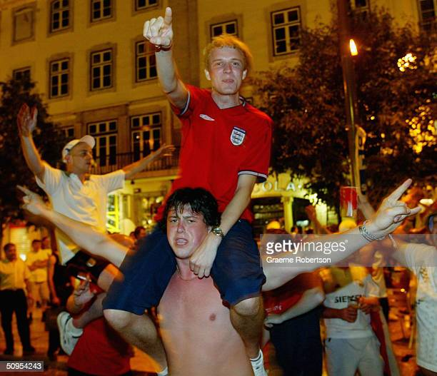 English fans celebrate in Rossio Square in June 12 2004 in Lisbon Portugal Riot police were called in to surround English fans after small pockets of...