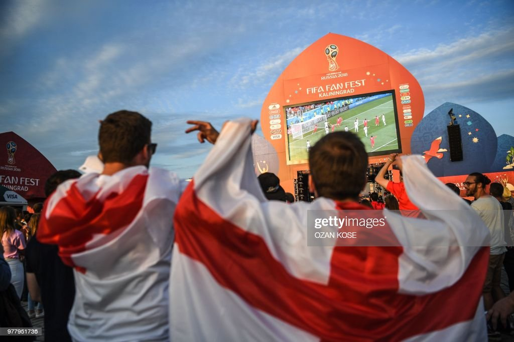 English fans celebrate their team's opener at the Fifa Fan Fest area in Kaliningrad as they watch the Russia 2018 World Cup Group G football match between Tunisia and England at the Volgograd Arena in Volgograd on June 18, 2018.