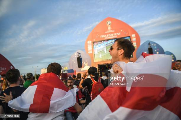 English fans celebrate their team's opener at the Fifa Fan Fest area in Kaliningrad as they watch the Russia 2018 World Cup Group G football match...
