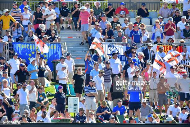 English fans celebrates New Zealand's Jeet Raval being caught during day two of the second cricket Test match between New Zealand and England at...