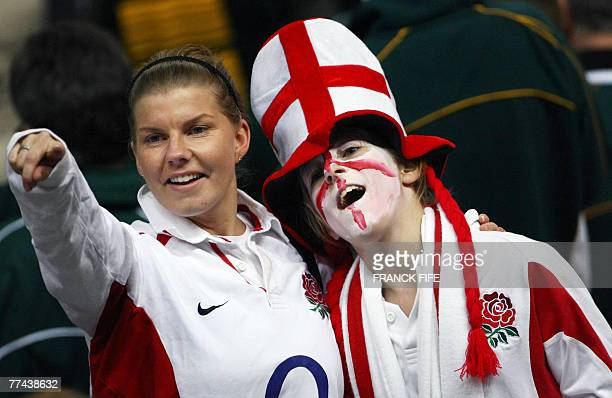 English fans cheer as they prepare to watch their team challenge South Africa prior to the Rugby union World Cup final match England vs. South...