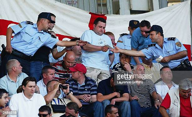 English fans get their tickets checked by Police during the Euro 2004 group 7 qualifying match between Macedonia and England on September 6 2003 at...