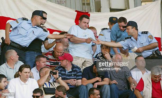 English Fans get their tickets checked by Poloce during the England v Macadonia European Cup Group 7 match on September 6 2003 in the City Stadium in...
