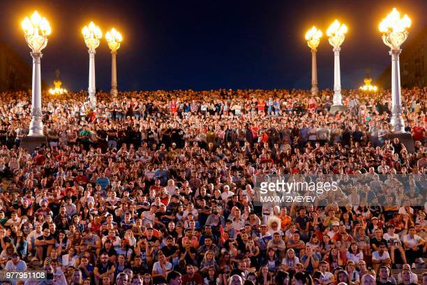 TOPSHOT English fans in a Fan Fest watch the Russia 2018 World Cup Group G football match between Tunisia and England at the Volgograd Arena in...