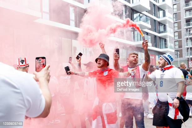 English fans with red smoke prior to the UEFA Euro 2020 Championship Final between Italy and England at Wembley Stadium on July 11, 2021 in London,...