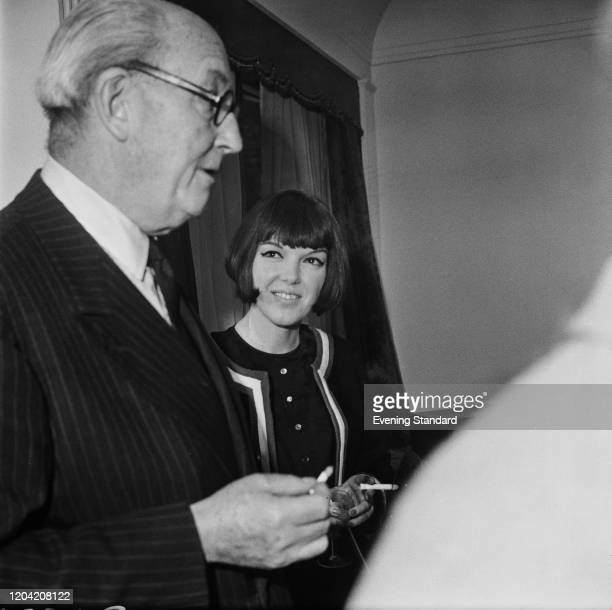English fashion designer and fashion icon Mary Quant and British art dealer Dudley William Tooth at an event UK 5th April 1962