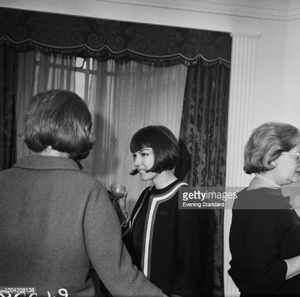 English fashion designer and fashion icon Mary Quant and others attend an event UK 5th April 1962