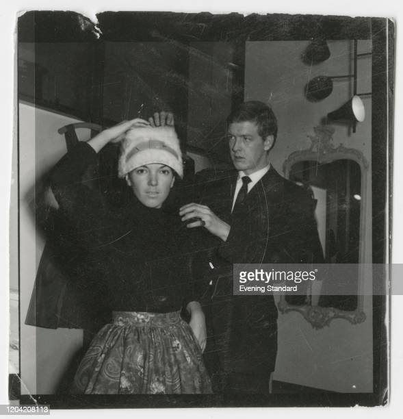 English fashion designer and fashion icon Mary Quant getting dressed with her husband and business partner British entrepreneur Alexander Plunket...