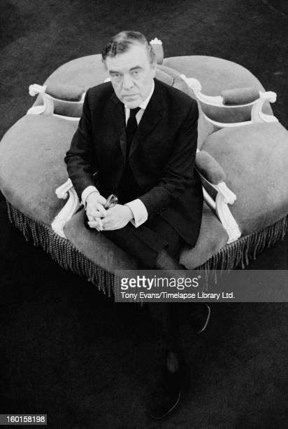 English fashion designer Norman Hartnell , dressmaker to the Queen, circa 1963.
