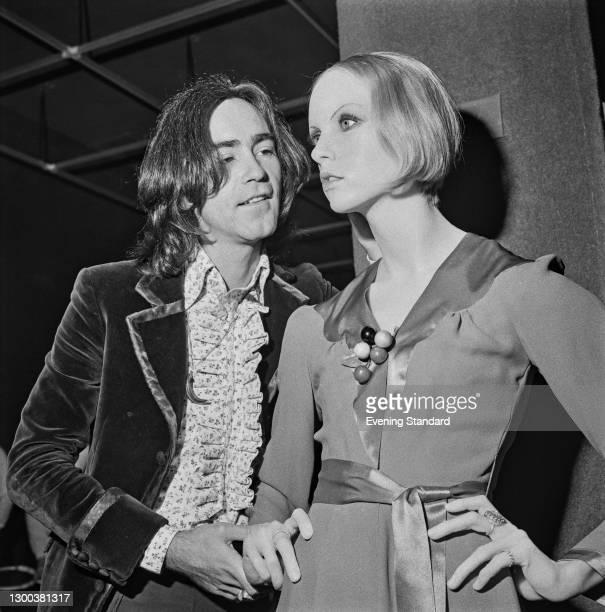 English fashion designer Ossie Clark with a wax dummy of supermodel Twiggy, UK, 16th May 1972.