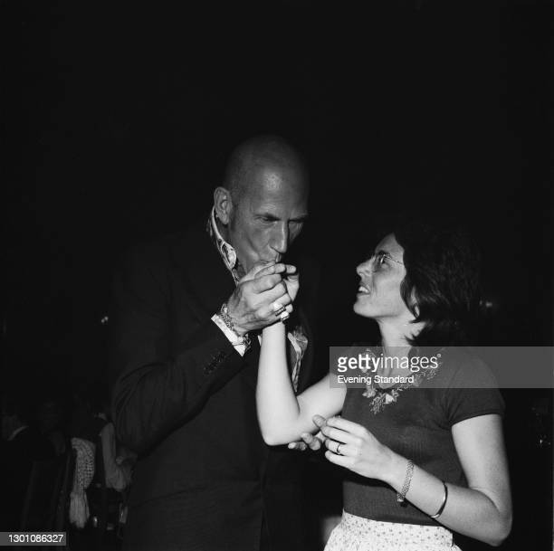 English fashion designer Ted or Teddy Tinling with American tennis player Billie Jean King, for whom he is designing a tennis dress, UK, 27th June...