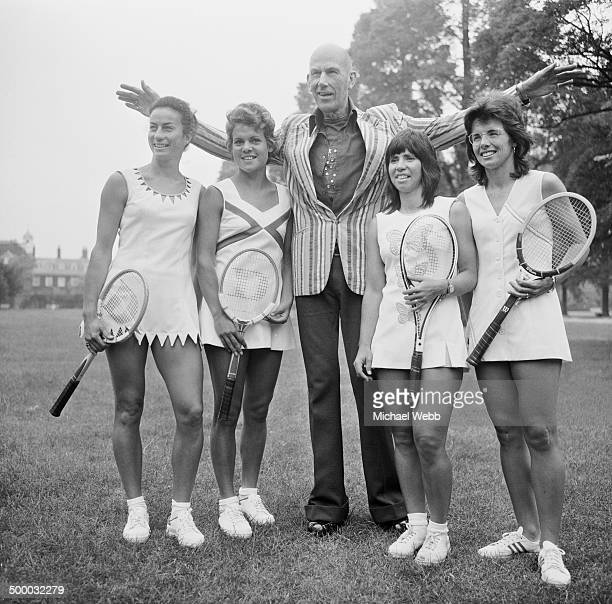 English fashion designer Ted Tinling , with tennis players wearing his Dacron fashions at the Royal Garden Hotel, Kensington, London, 22nd June 1973....