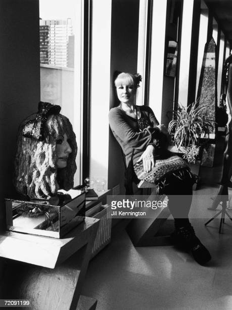 English fashion designer Zandra Rhodes circa 1990 To the left stands a glass mosaic bust of her by sculptor and colleague Andrew Logan