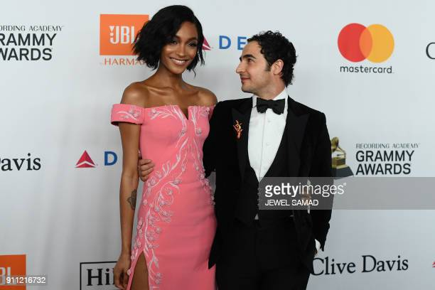 English fashion model and actress Jourdan Dunn and American fashion designer Zach Posen arrive for the traditionnal Clive Davis party on the eve of...