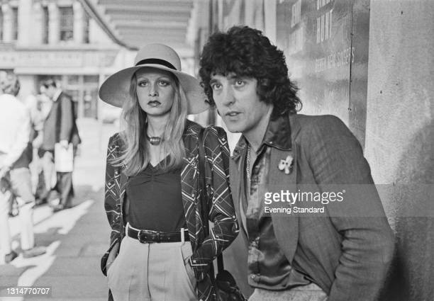 English fashion model and actress Twiggy with her former partner and manager Justin de Villeneuve outside the Prince of Wales Theatre in London, UK,...