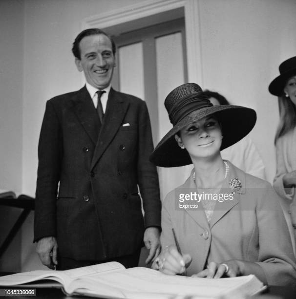 English fashion model and former Merchant Navy sailor April Ashley pictured signing the marriage register with her husband Arthur Corbett on the day...