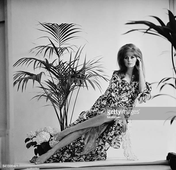 English fashion model Paulene Stone shows a muumuu dress in cotton muslin print 13th March 1967