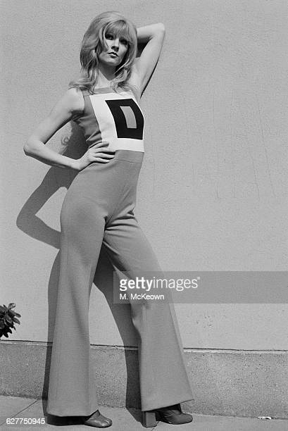 English fashion model Paulene Stone wearing a 'City' trouser suit UK 28th April 1971