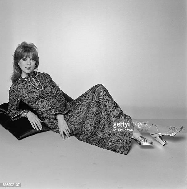 English fashion model Paulene Stone wearing a paisleypatterned kaftan UK 4th May 1971