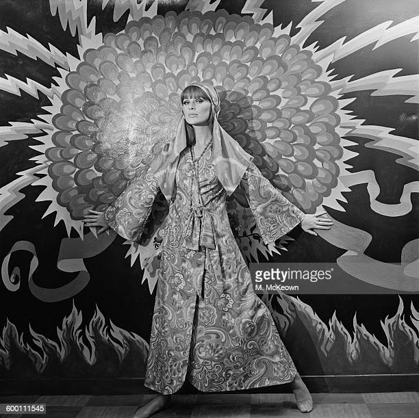 English fashion model Paulene Stone wearing a psychedelic robe to be sold in the new Apple Boutique in London UK 29th November 1967 The shop was...