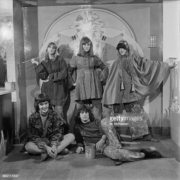 English fashion model Paulene Stone with members of The Fool design collective at the new Apple Boutique in London UK 29th November 1967 The shop was...