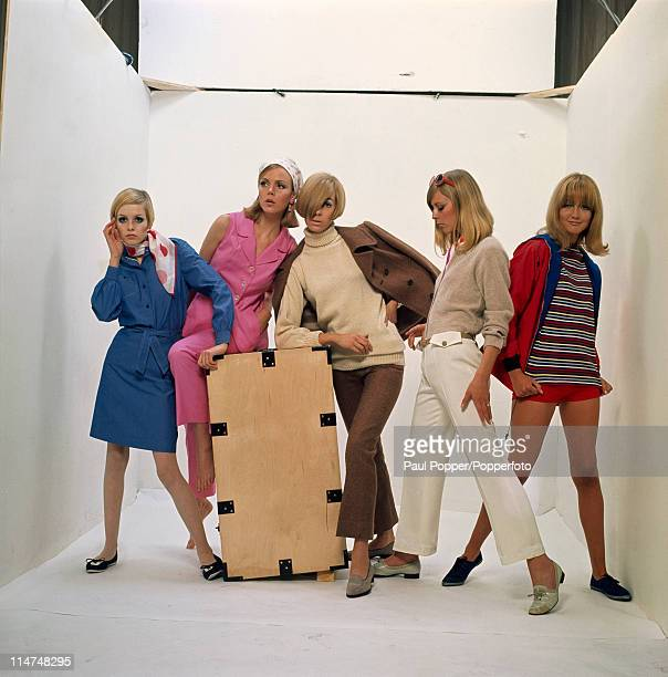 English fashion model Twiggy poses with four other models and a wooden crate 1966