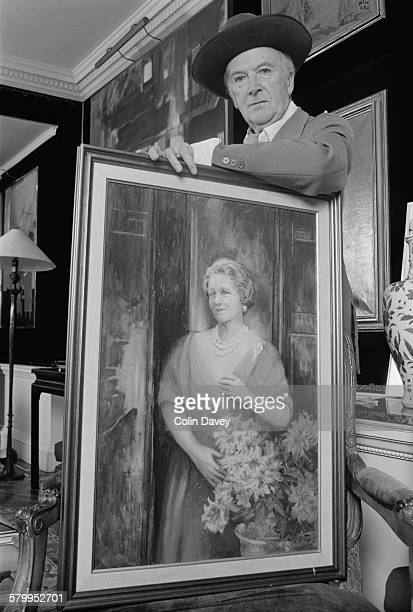 English fashion photographer Cecil Beaton with one of his paintings UK circa 1972