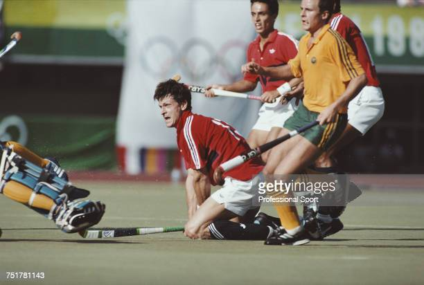 English field hockey player Sean Kerly scores one of his three goals during the semi final match of the Men's field hockey tournament between...