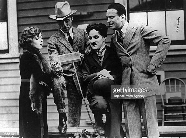 English film actor and director Charles Spencer Chaplin with American actress Mary Pickford American actor Douglas Fairbanks and American film...