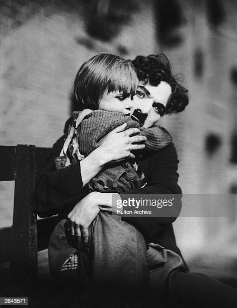 English film actor and director Charlie Chaplin and US child actor Jackie Coogan in a scene from the film 'The Kid'