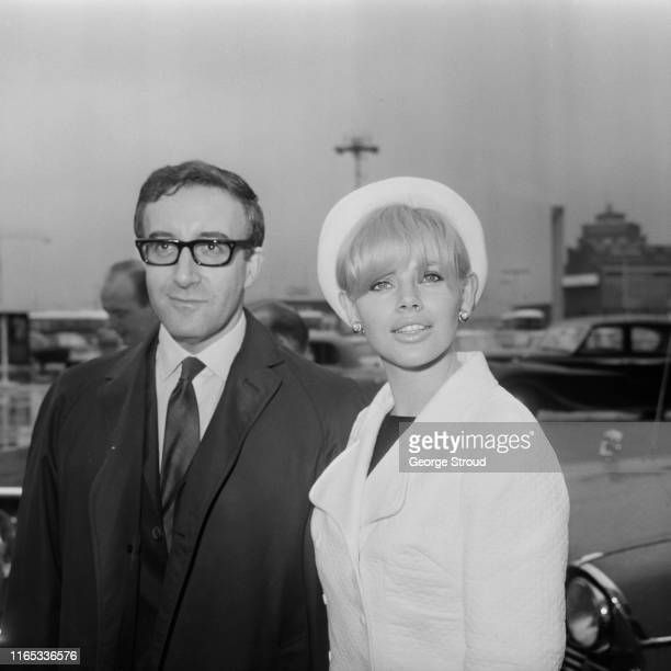 English film actor, comedian and singer Peter Sellers and his wife, Swedish actress and singer Britt Ekland at an airport, UK, 23rd March 1965.