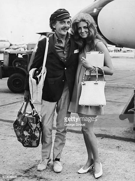 English film actor David Hemmings and his fiancee actress Gayle Hunnicutt at London Airport 30th August 1967