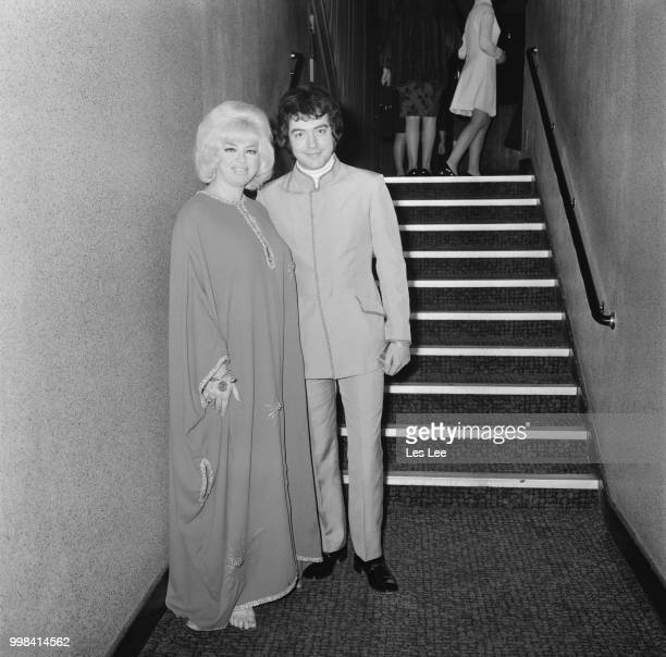 English film actress and singer Diana Dors with her husband Alan Lake at the premiere of crime comedy film 'Crooks and Coronets' at the Warner West...