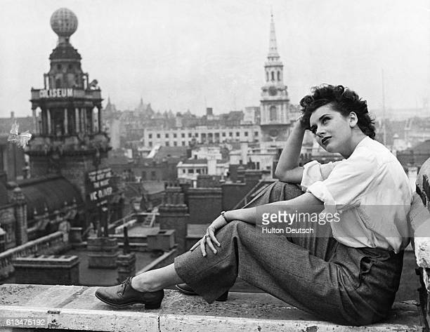 English film and stage actress Kay Kendall relaxing on the roof of her flat in London