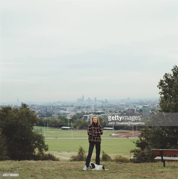 English film and television actress Amanda Donohoe with her dog on Parliament Hill London circa 1995