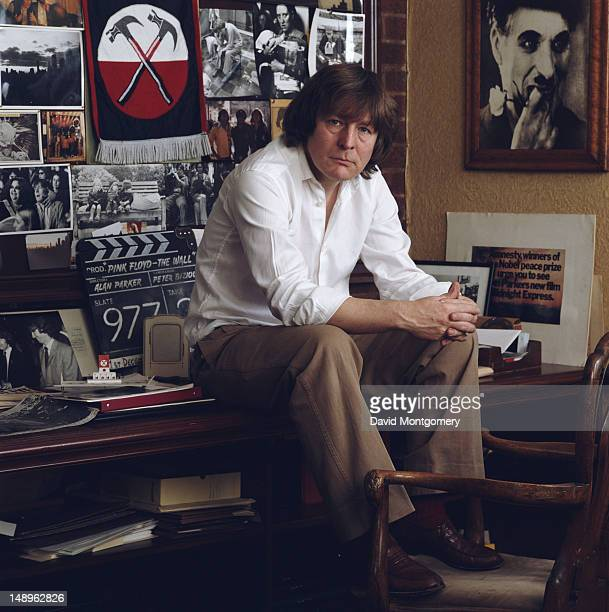 English film director Alan Parker circa 1990 Behind him is a clapperboard from the film 'Pink Floyd—The Wall' which he directed