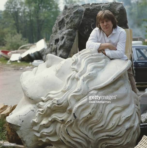 English film director Alan Parker with a huge plaster head circa 1990