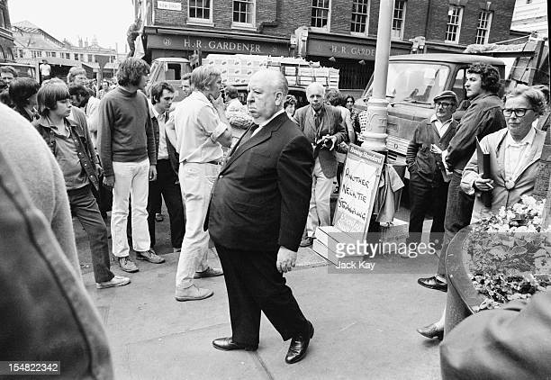 English film director Alfred Hitchcock during location filming in Covent Garden London for his film 'Frenzy' 26th July 1971 The set is dressed with a...