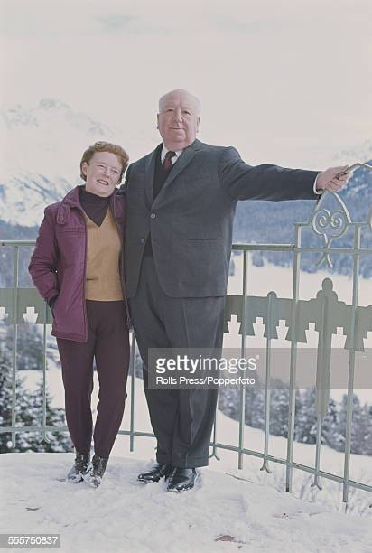 English film director Alfred Hitchcock pictured with his wife Alma Reville at the ski resort of St Moritz in Switzerland in 1966