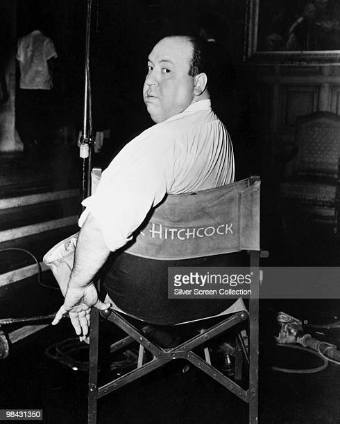 English film director Alfred Hitchcock poses on a film set circa 1940