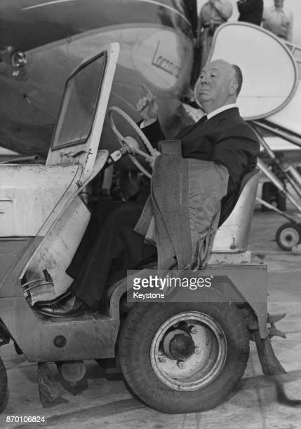 English film director Alfred Hitchcock rides a baggage trolley upon his arrival at Paris airport France 1st October 1960