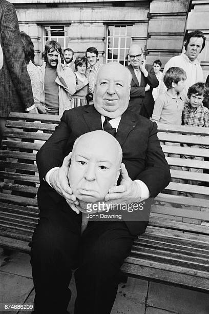 English film director Alfred Hitchcock with a model of his own face on the set of his latest film 'Frenzy' London UK 27th August 1971